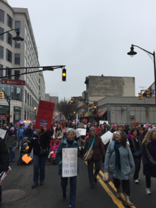 Thousands of men and women marching on the streets of Trenton. Source: Emma Piasick